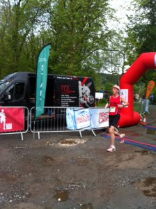 Richard crossing the finishing line